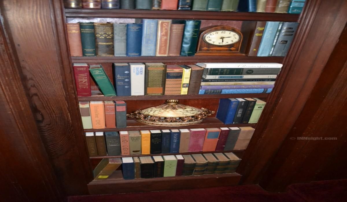 Cedar Gables Inn Interior - Bookcase in Stairwell