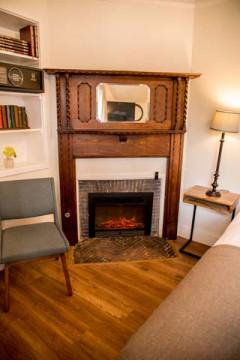 Cedar Gables Inn Miss Dorothys Room - Fireplace and Reading Area